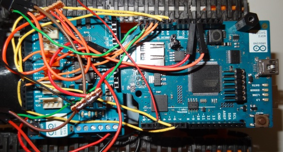Arduino Uno stacked with wifi shield and connected to motor shield